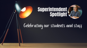 Superintendent Spotlight, Celebrating our students and staff - image of stage with spotlight